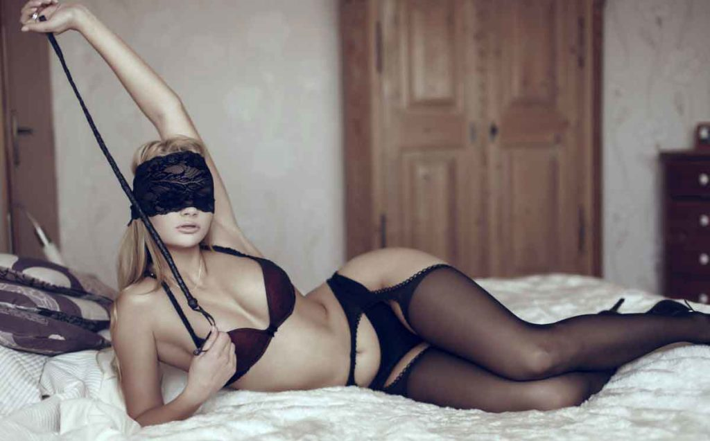 a blindfolded wife on the bed
