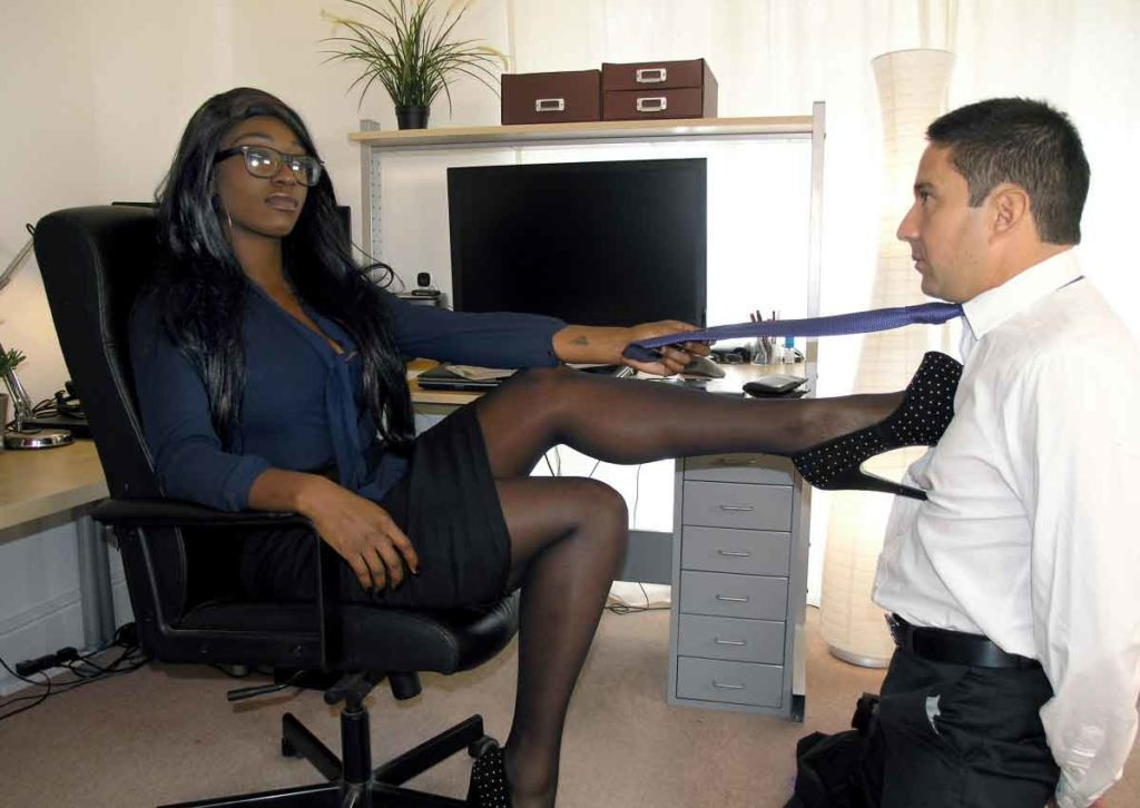 an ebony mistress abusing a slave at the office