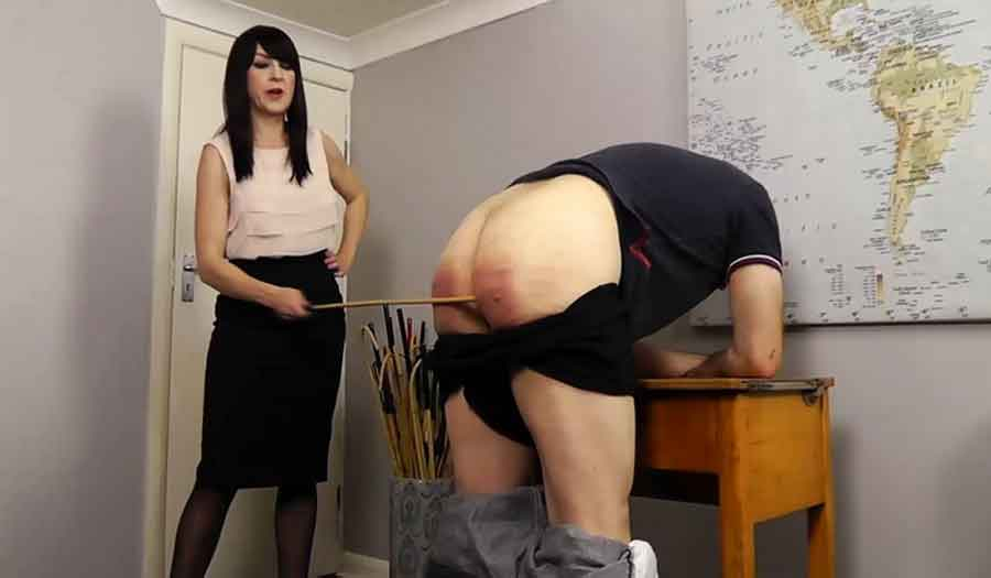 a femdom caning a slave