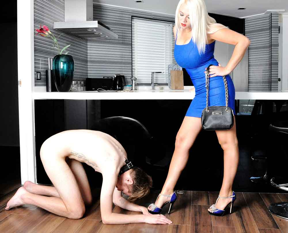 a mistress having her shoes kissed
