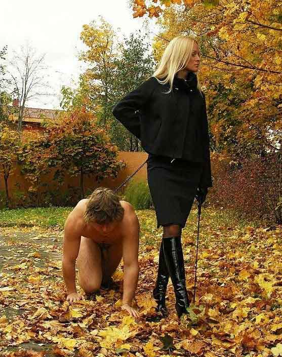 a mistress walks in the park with slave