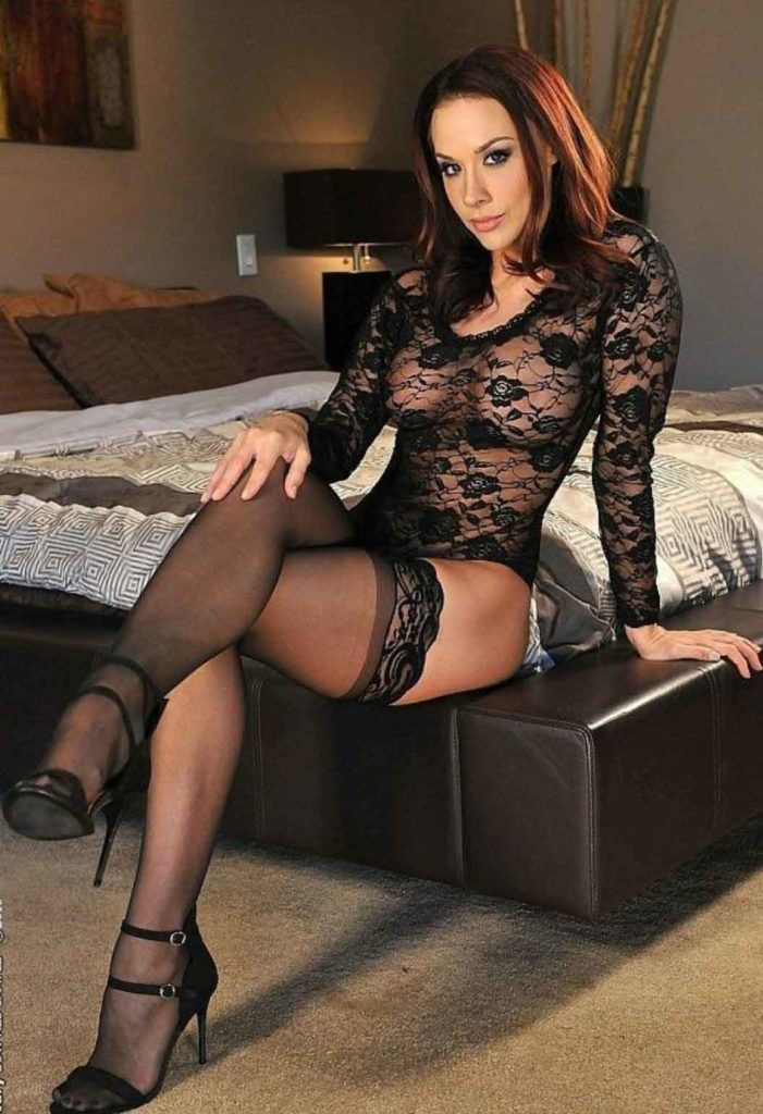 a mistress sitting on the side of a bed