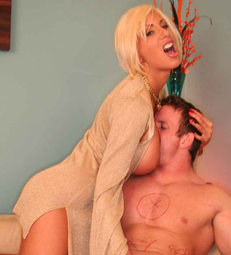 a mistress teasing with her breasts
