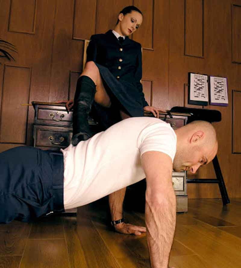 a mistress with her foot on slaves back