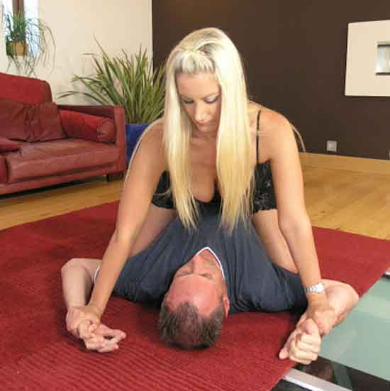 a mistress pinning a slave down