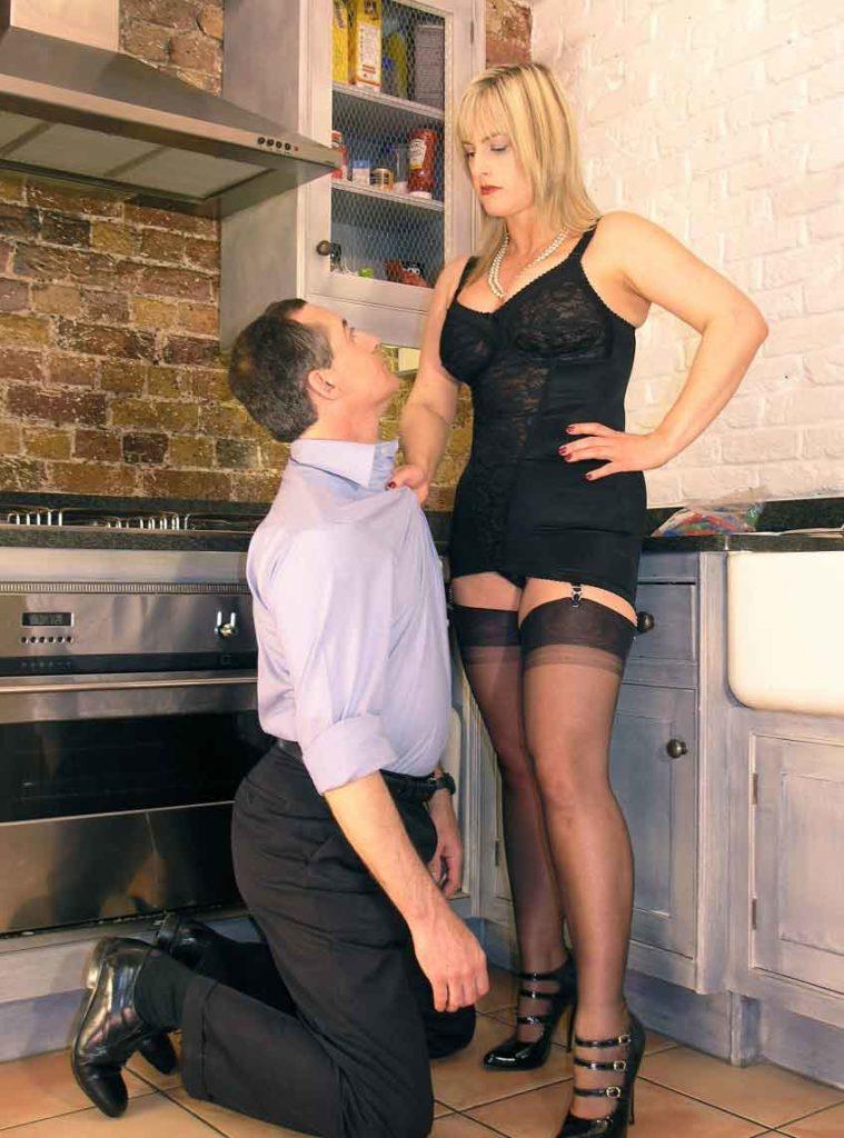 a mistress grabbing a kneeling slave
