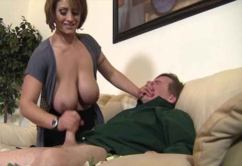 a bare breasted mistress masturbating slave
