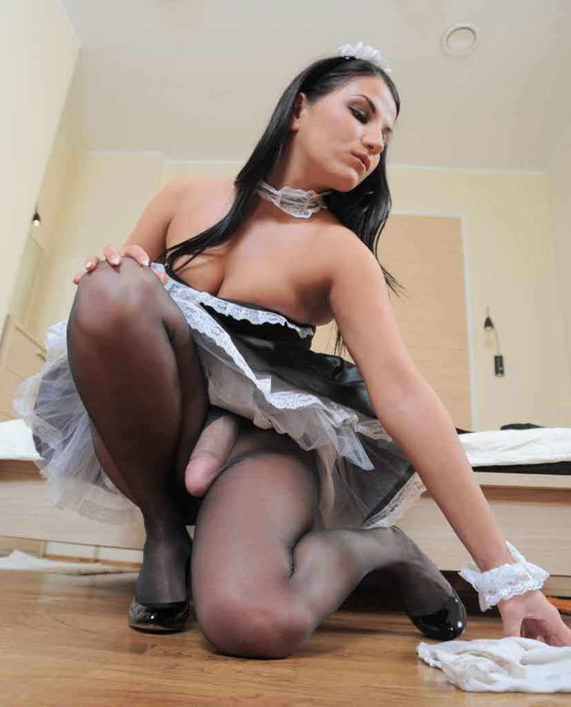 a mistress maid picks something from the floor