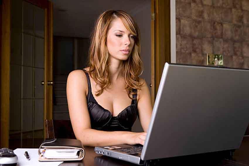 mistress reading on a laptop