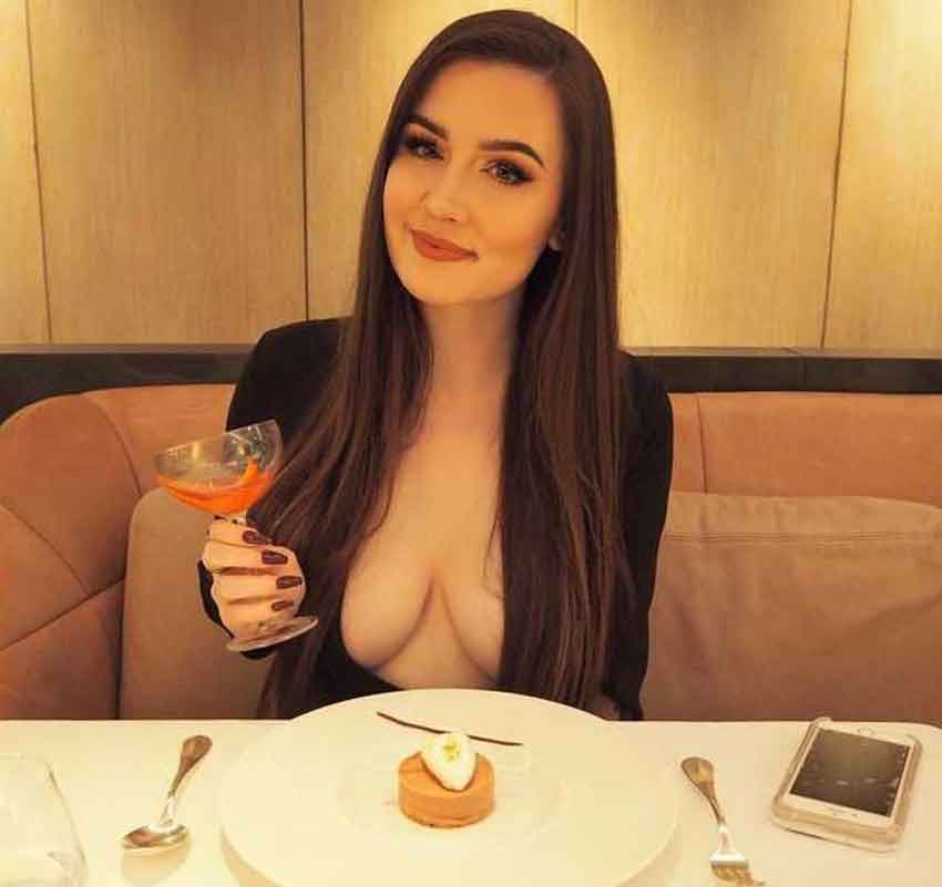 a mistress with cleavage at a restaurant