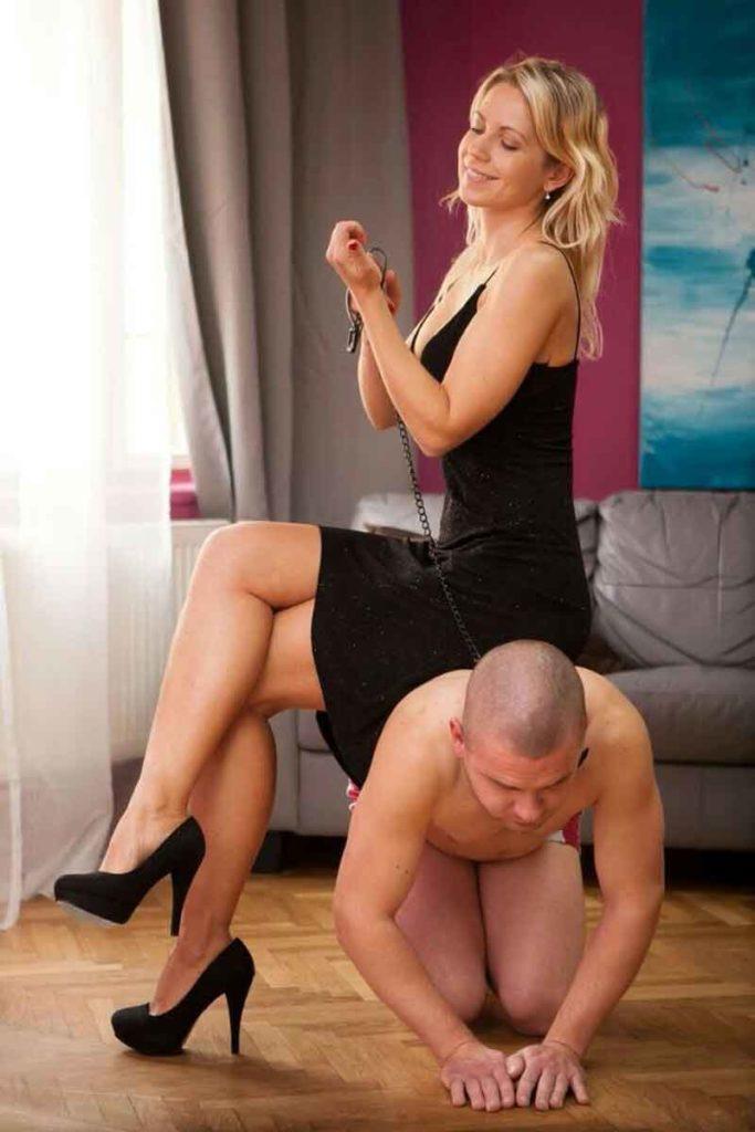 a mistress sitting on a slave