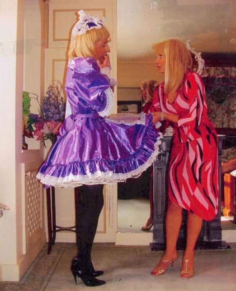 a mistress lifting up skirt from a sissy maid