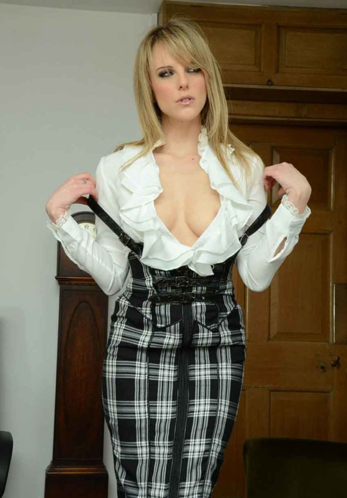 a headmistress shows cleavage