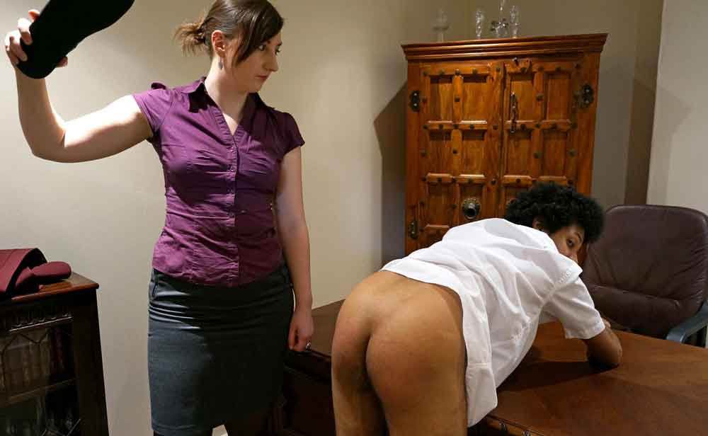 a headmistress in a purple blouse spanking a naughty schoolboy