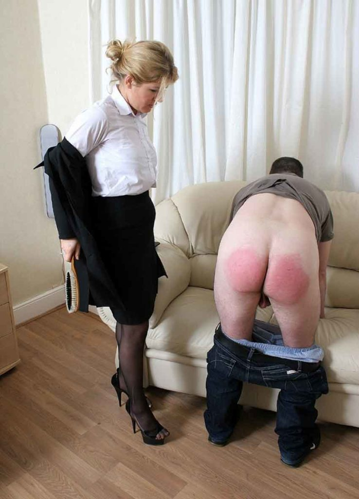 a mistress taking off her jacket to deliver a spanking