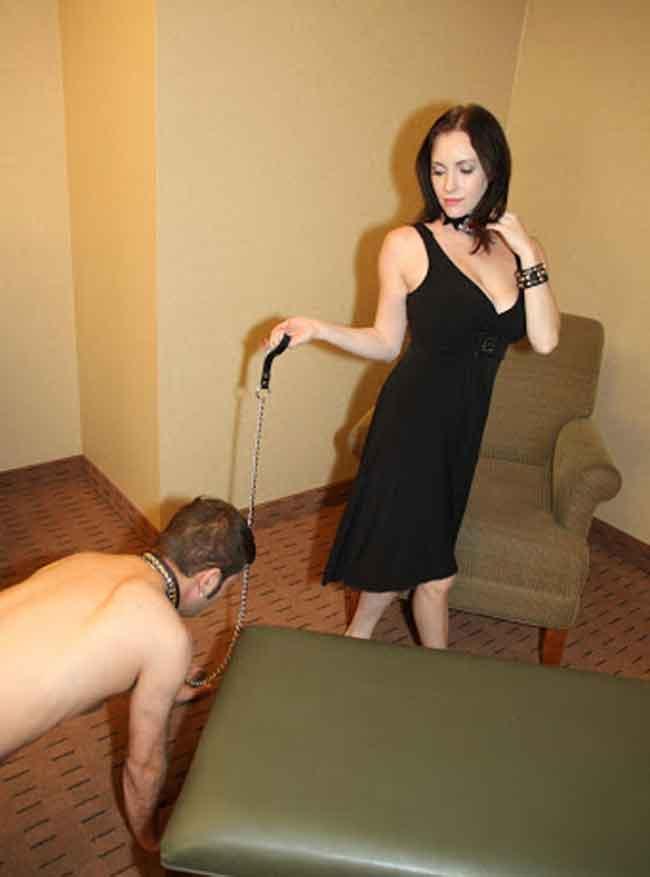 a mistress dragging a sub around on a leash