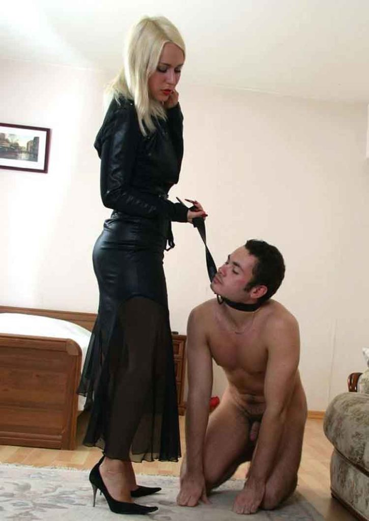 a mistress with a kneeling sub on a collar