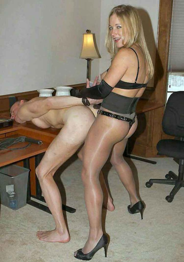 a mistress in nylons pegging her submissive