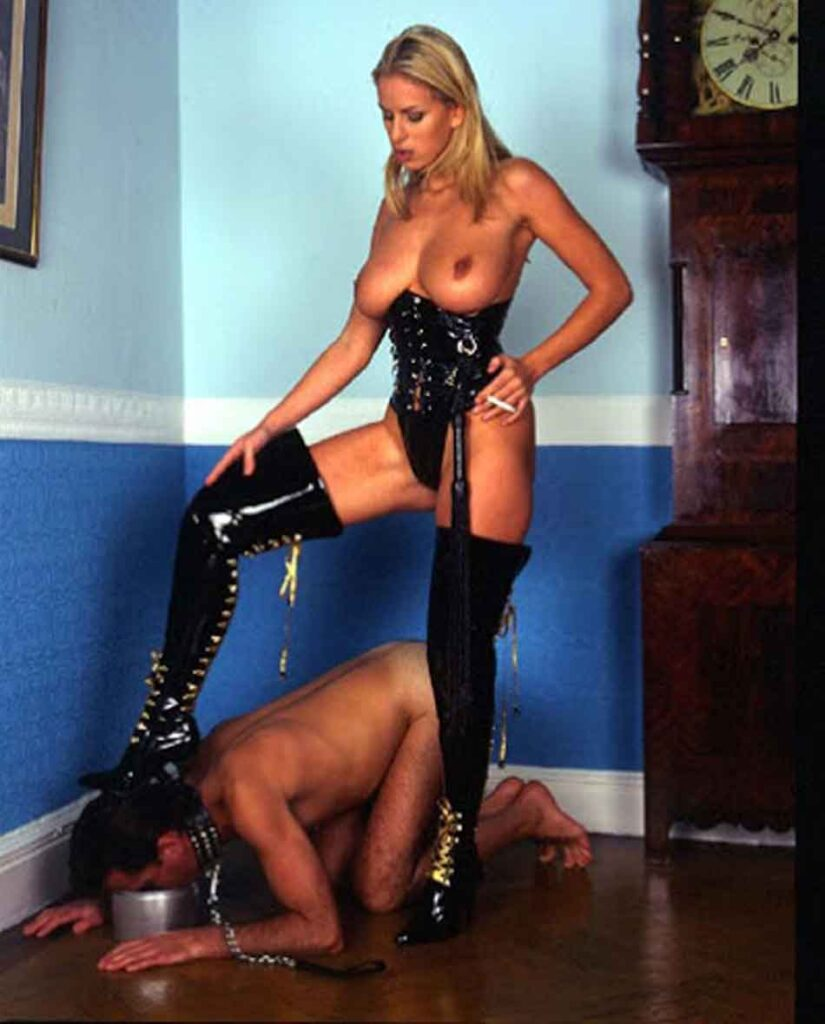 a mistress forcing a slave to eat from a dog bowl
