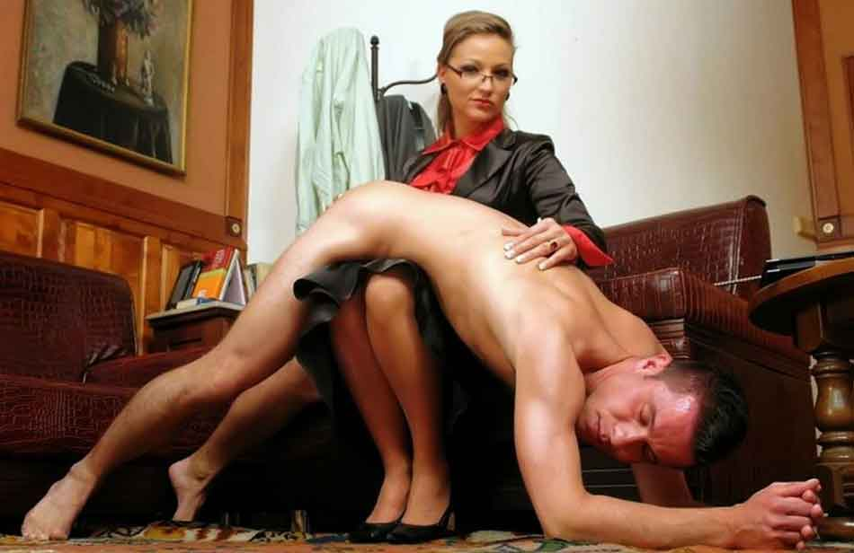 a mistress striking a bottom with a hand over the knee