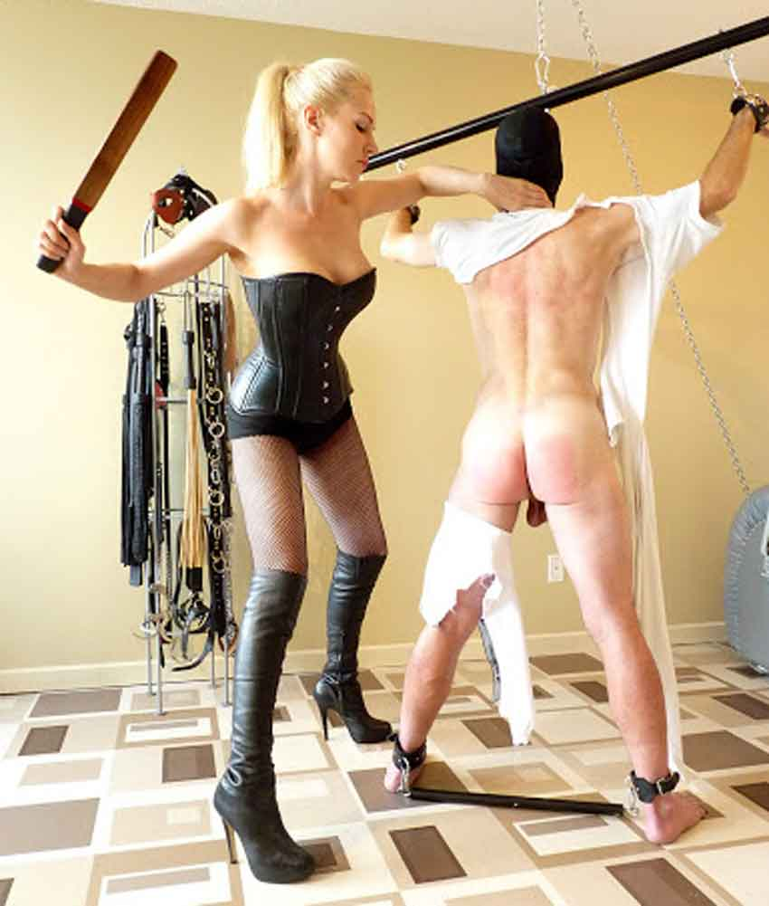 a mistress striking a bottom with a paddle