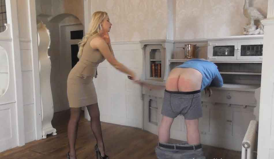 a mistress striking a subs bottom with strap