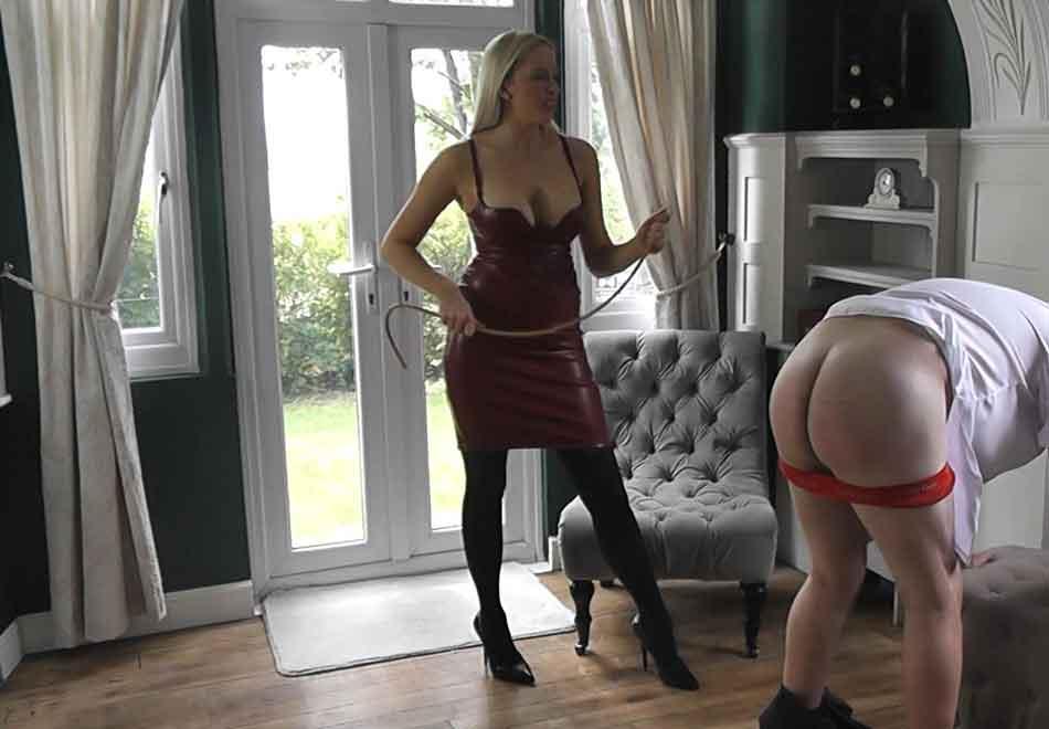 a mistress bending a cane near subs bottom