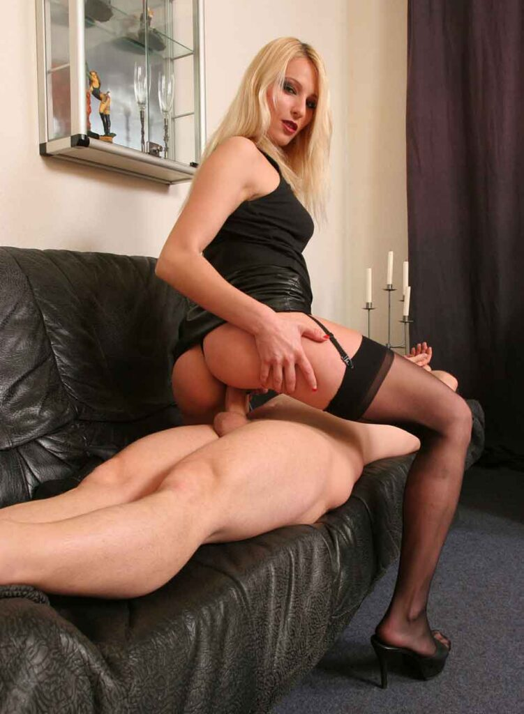 a mistress rides a sub on the couch