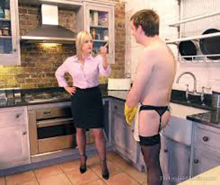 a mistress stands in front a husband at the cooker