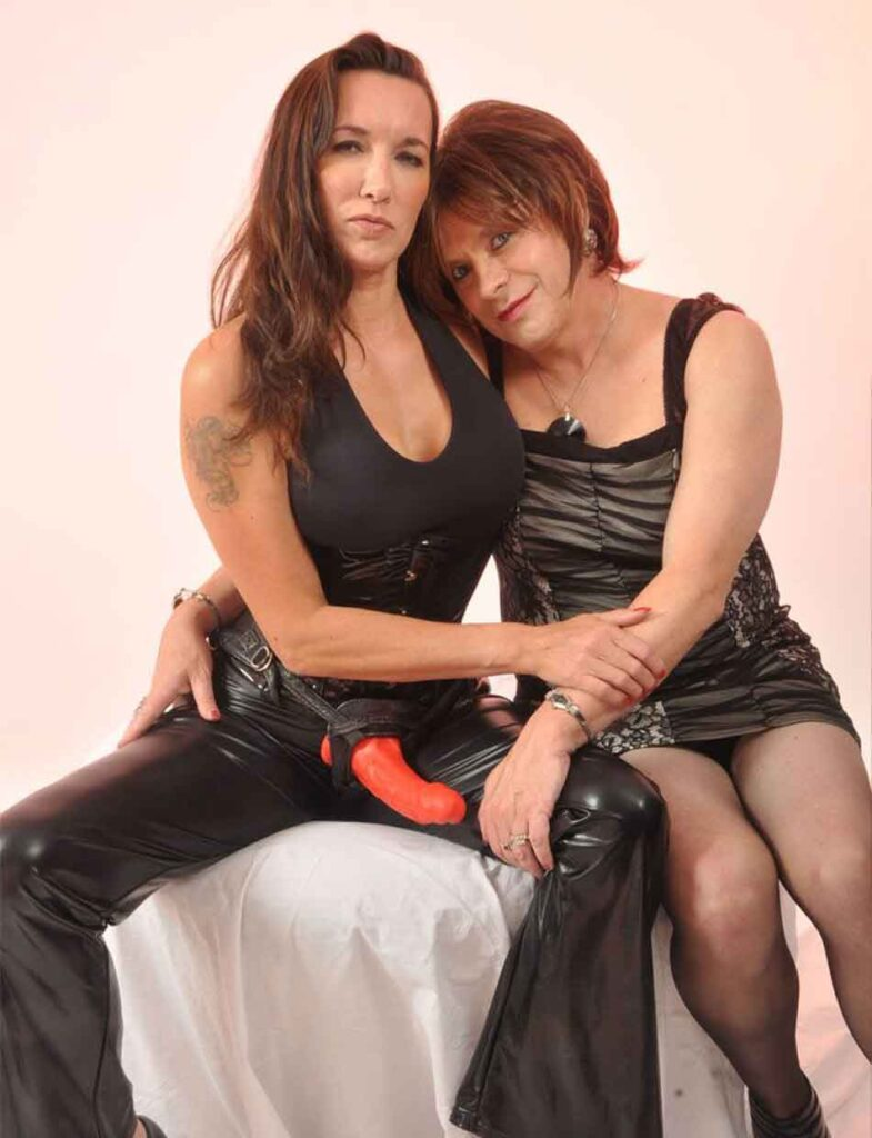 a mistress hold sub in leather dress