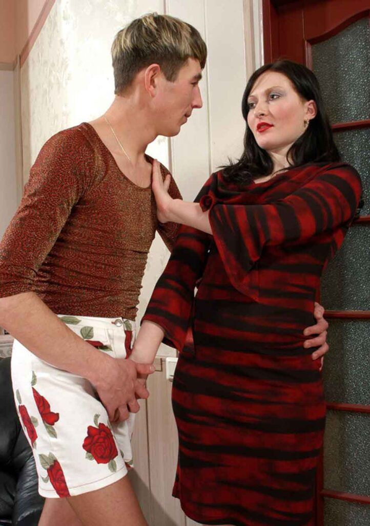 a mistress directing a sub in female clothing