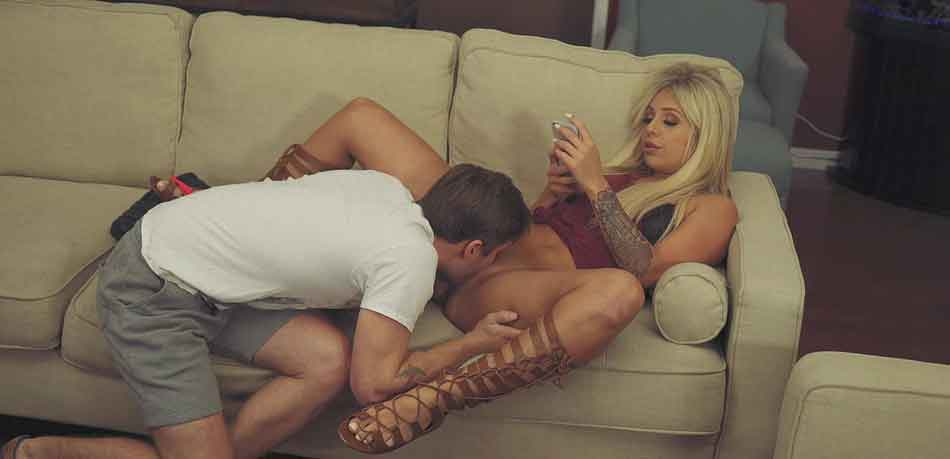 a mistress erceiving oral on the couch