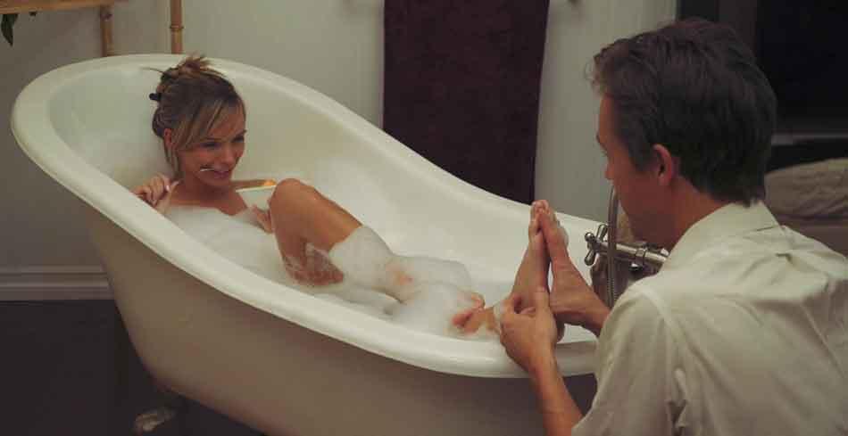 a mistress having a foot rub in bath