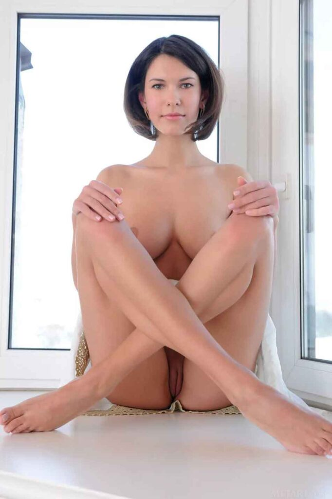 a naked mistress cross legged staring front