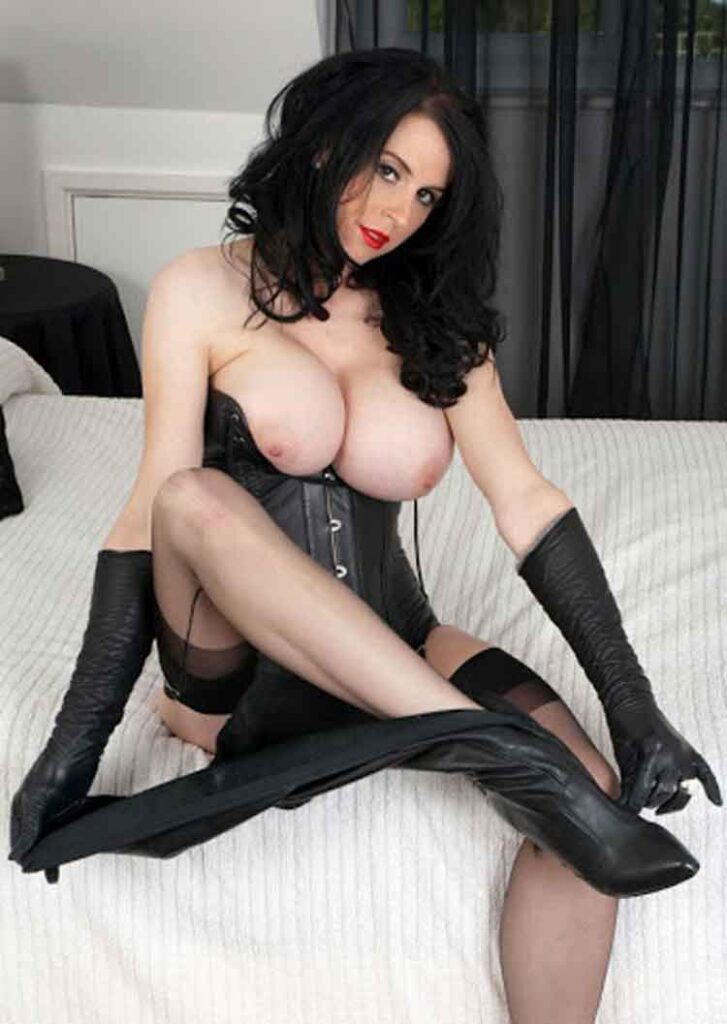 a mistress removes her boots on bed
