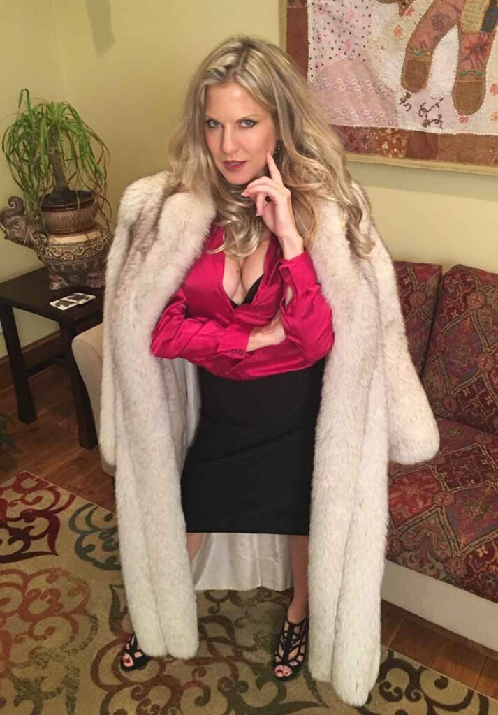 a mistress stands in mink coat
