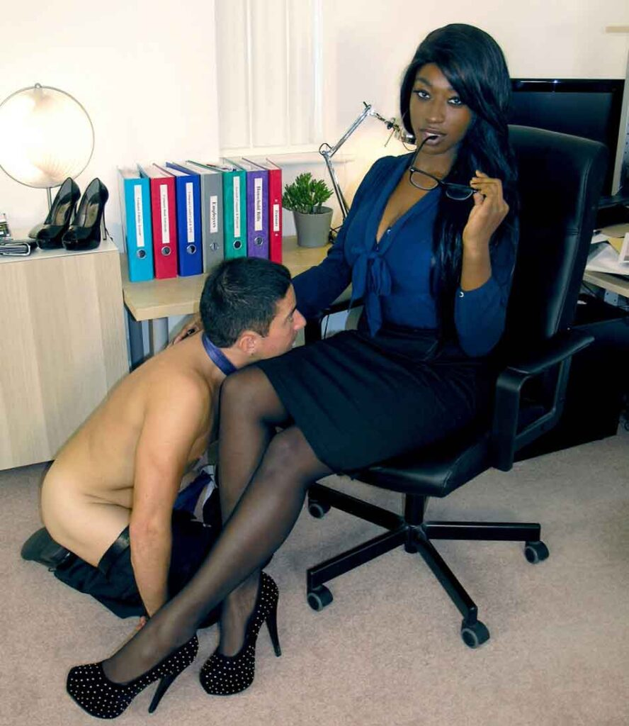 a mistress has a hun kneeling at her thigh