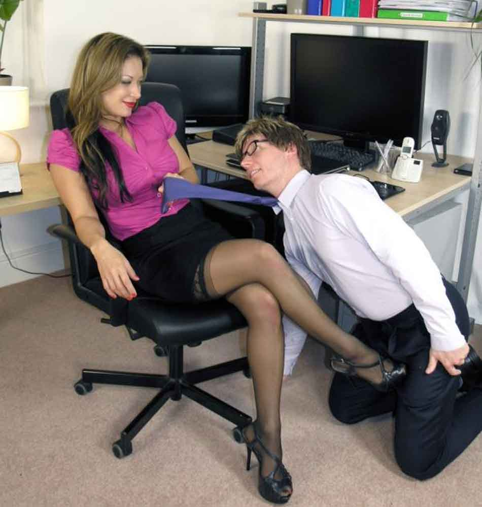 a mistress pulls a tie to sub oves towards her on a chair