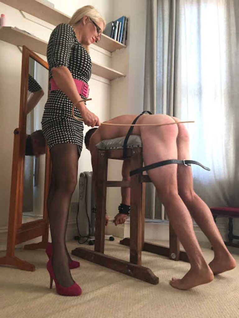a mistress caning her sub
