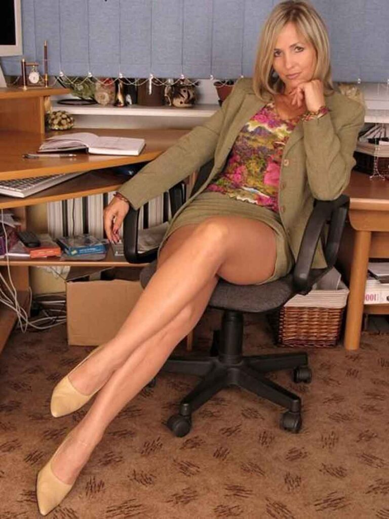 a mistress looking relaxed on a chair