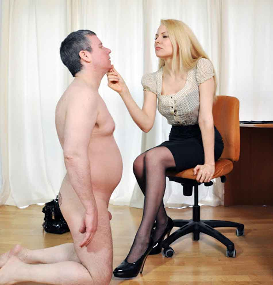 a mistress holds kneeling subs chin