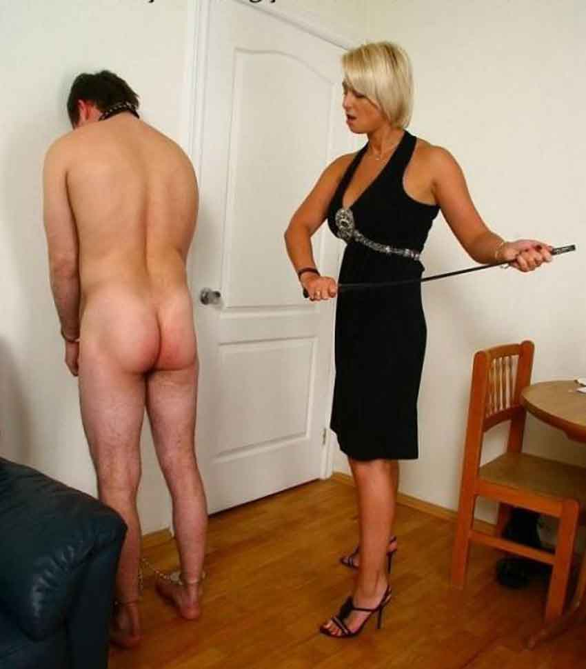 a mistress about to cane a standing sub