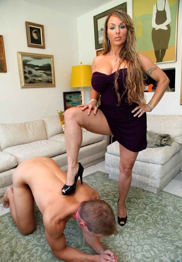 a mistress with heel on kneeling subs back