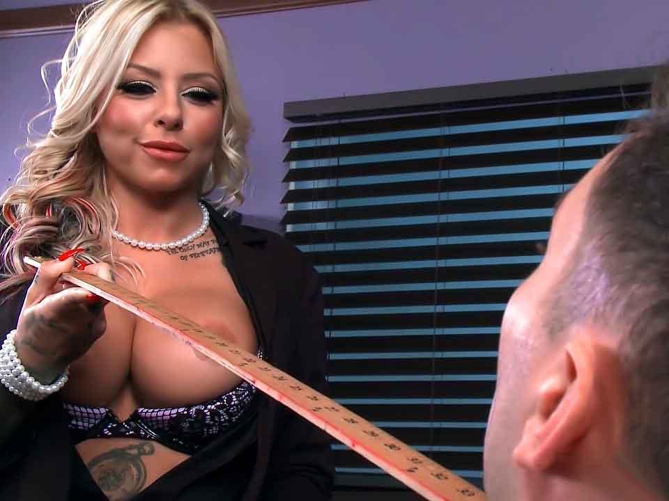 a mistress putting a ruler under a sub chin