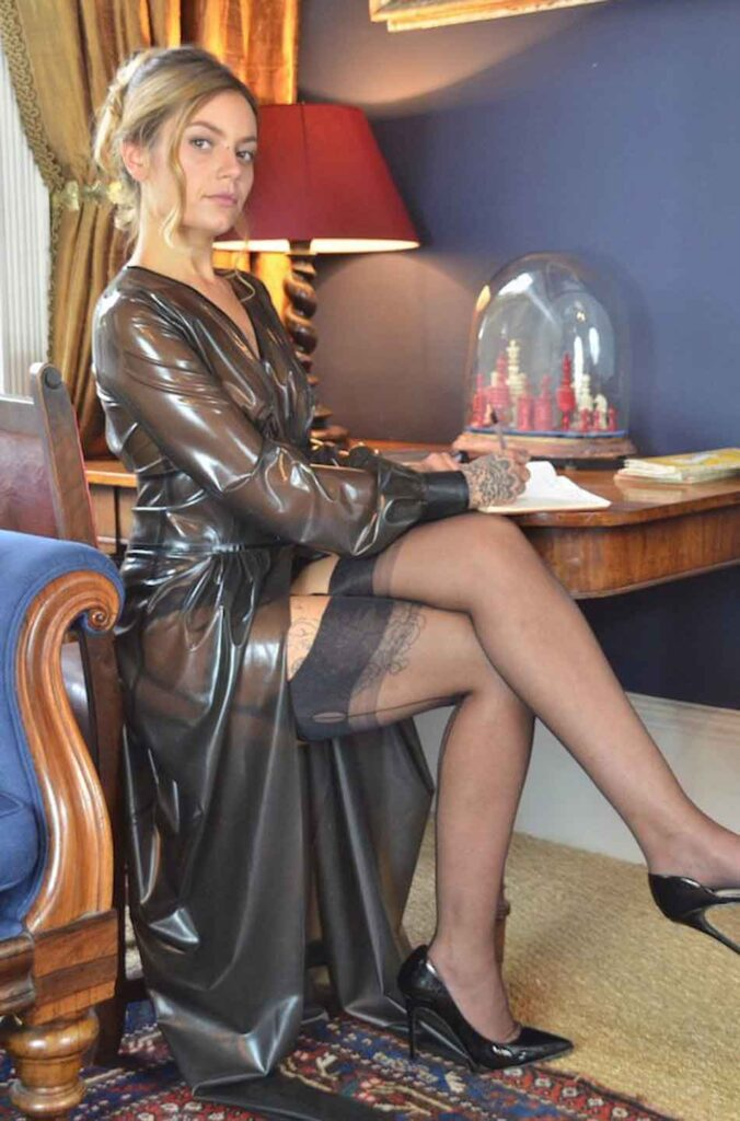 an elegant mistress sits at a desk