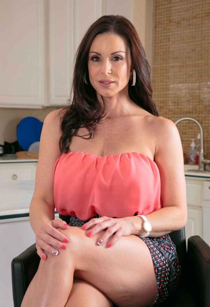 a mistress sits at kitchen chair