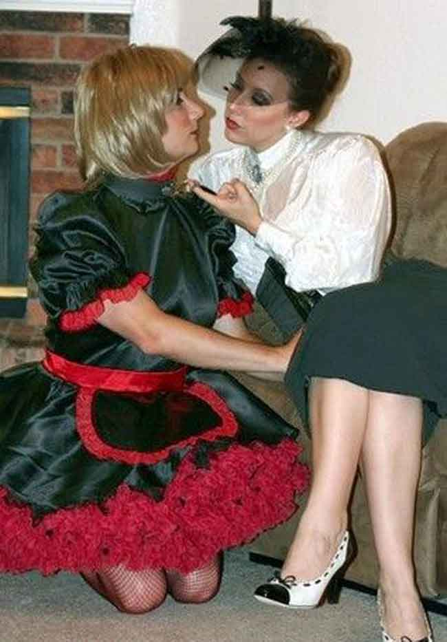 a sissy maid posing with mistress