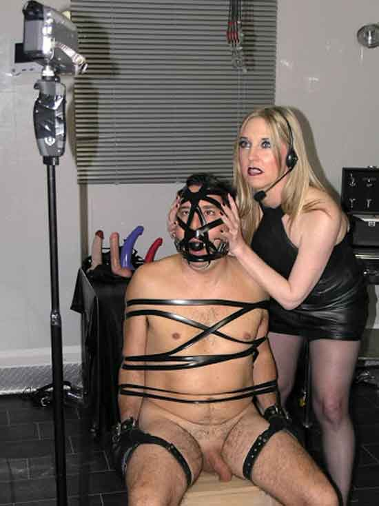 a mistress and sub in front of a camera