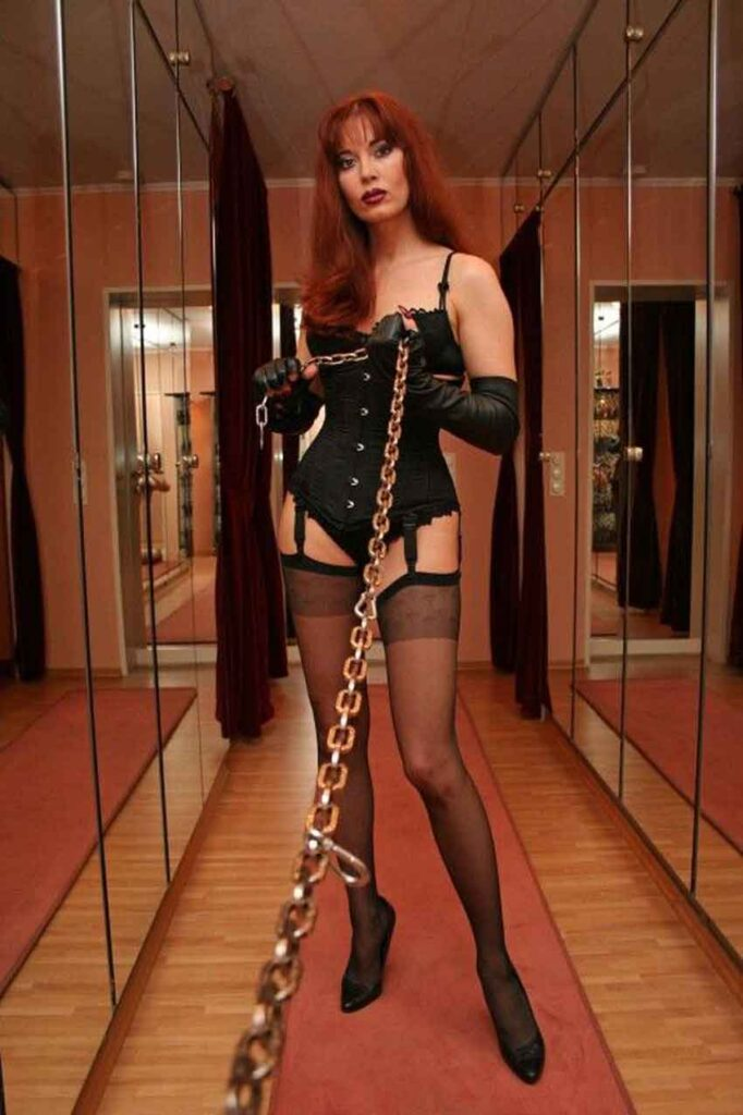 an elegant mistress holding a chain