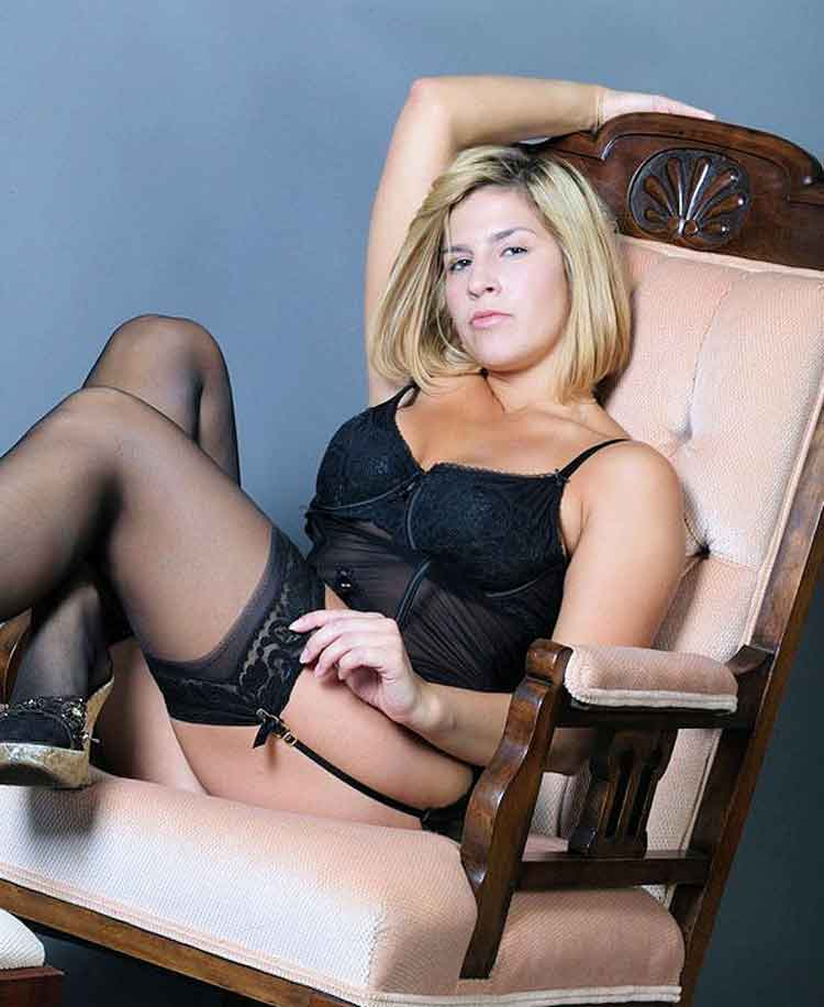 a mistress in lingerie on chair